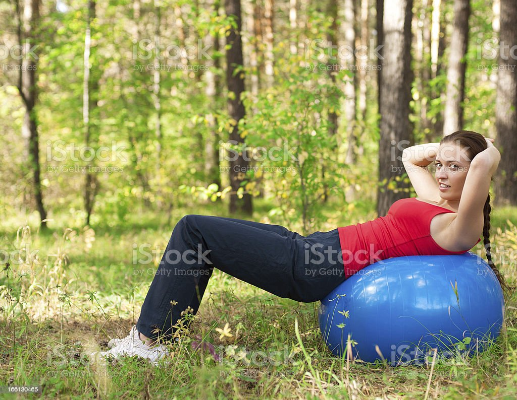 Woman exercising with fitness ball royalty-free stock photo