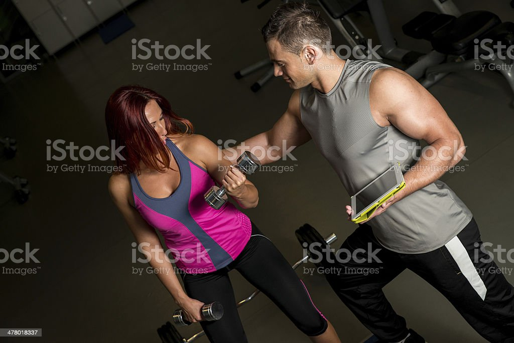 woman exercising with instructor using digital tablet royalty-free stock photo