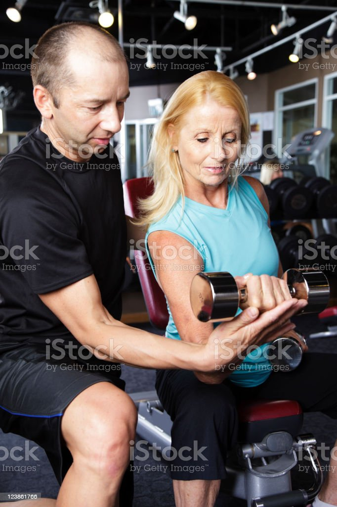Woman Exercising with Training Coach royalty-free stock photo