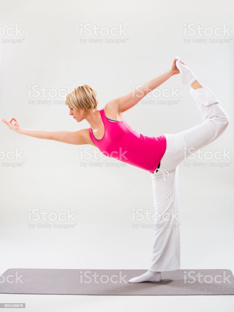 Woman exercising yoga stock photo
