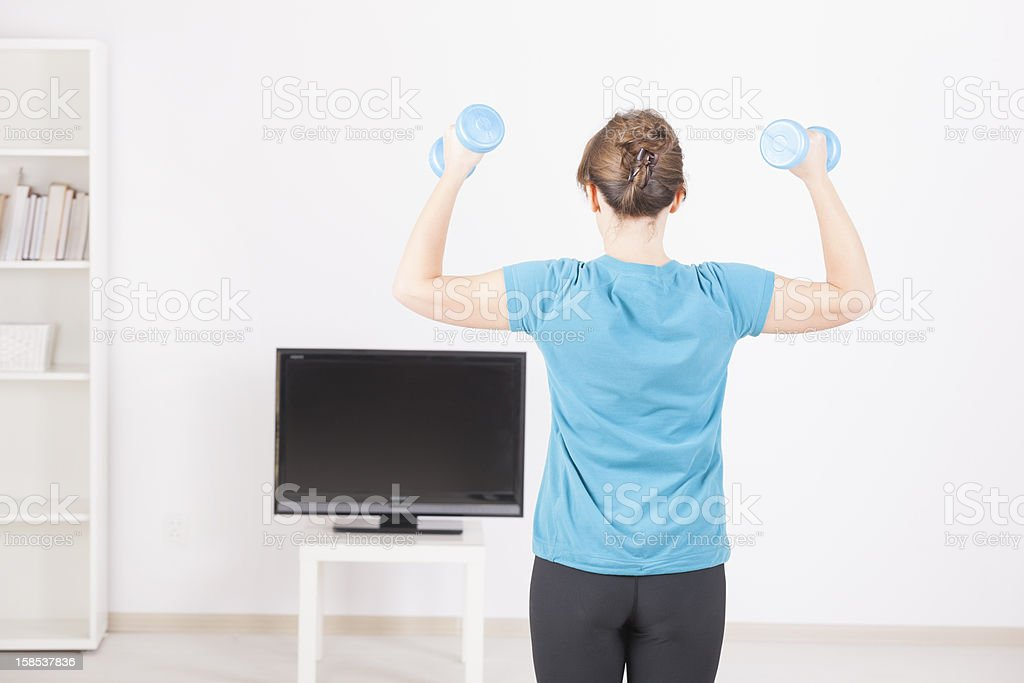 Woman exercisng at home royalty-free stock photo