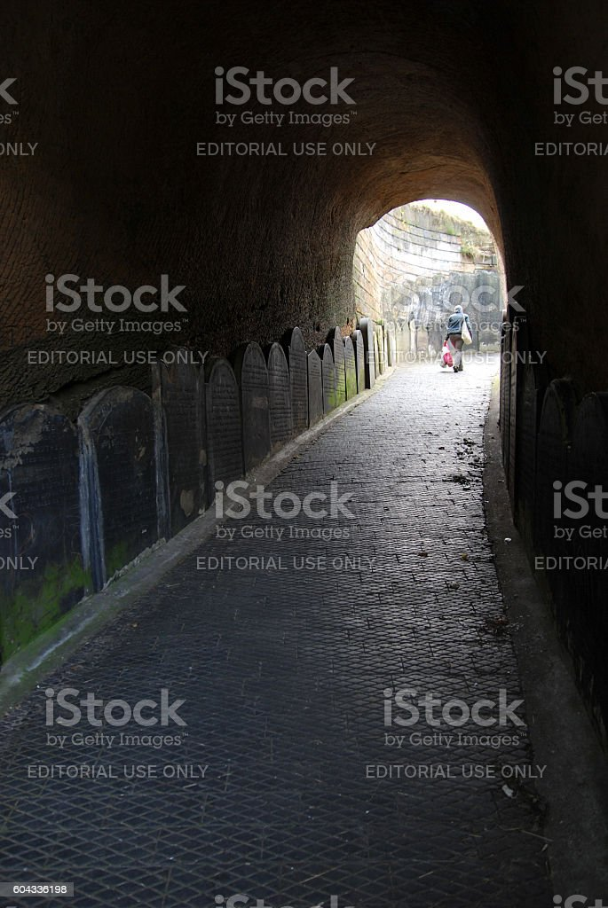Woman exiting tunnel from St James Cemetery to Liverpool Cathedral stock photo