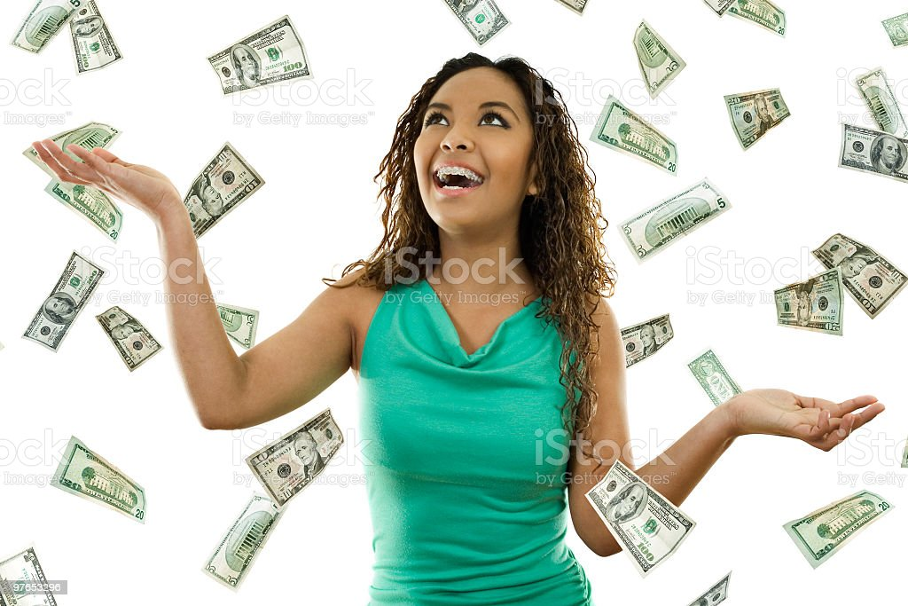 A woman experiencing the sky raining money stock photo