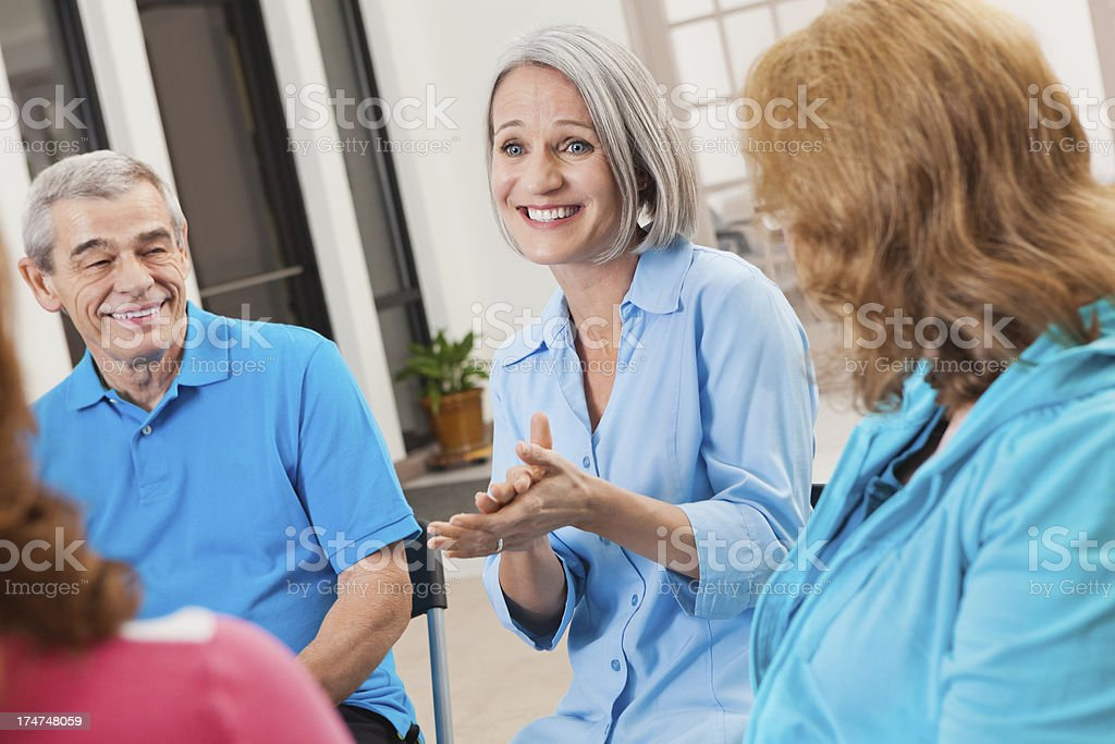 Woman explaining something to a group of friends royalty-free stock photo