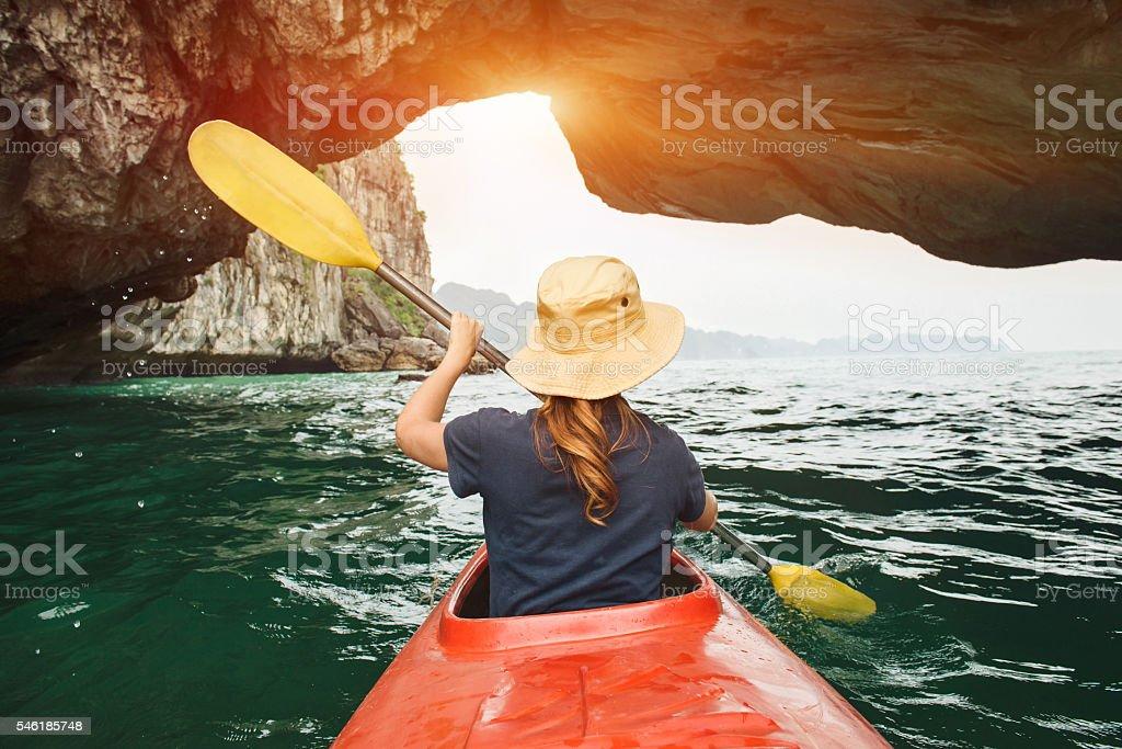 Woman explore Ha Long Bay on kayak stock photo
