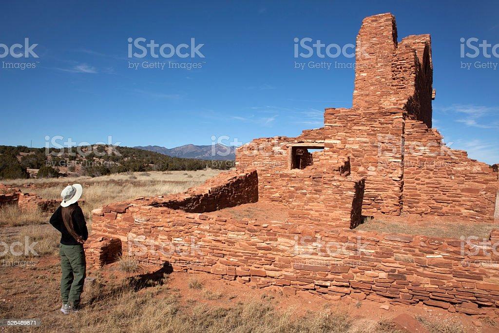 Woman explores Abo Ruins Salinas Pueblo Missions stock photo
