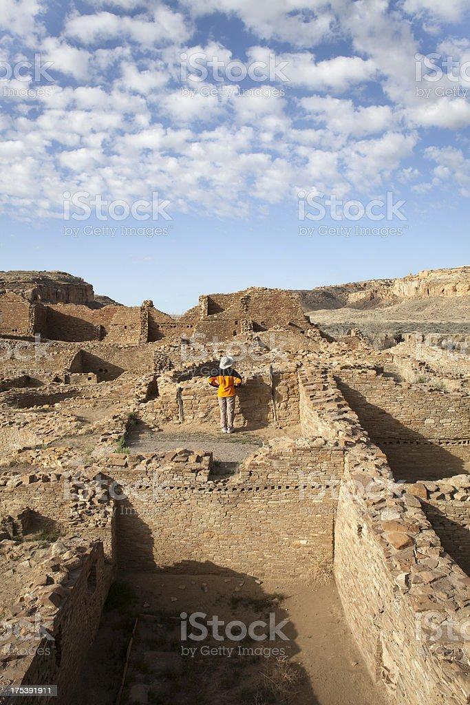 Woman explores inside ancient ruins Chaco Canyon NHP stock photo