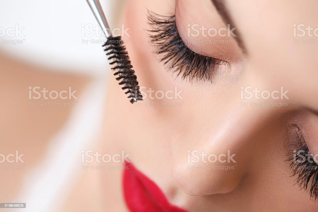 Woman eye with beautiful makeup and long eyelashes. Mascara Brus stock photo