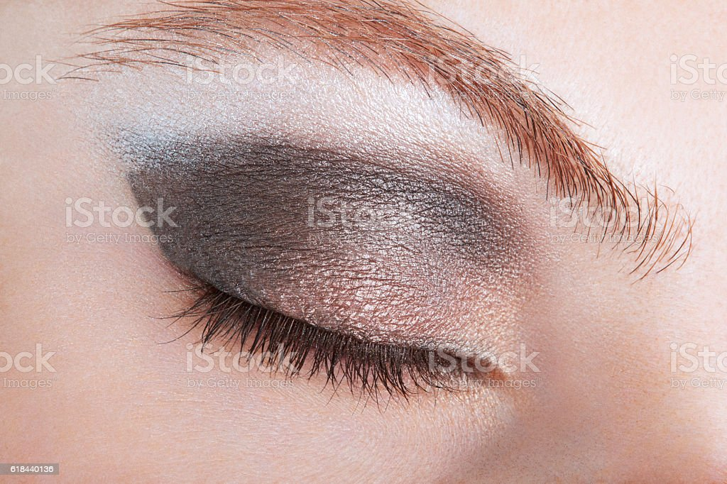 Woman eye with bronze smokey make up stock photo
