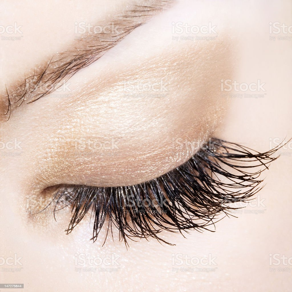 Woman eye with extremely long eyelashes stock photo