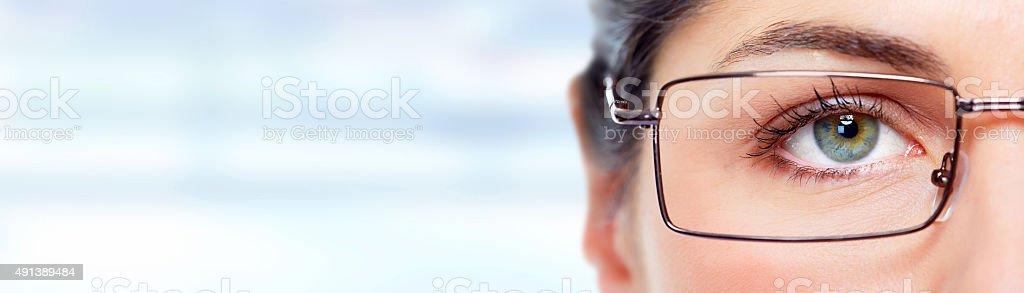 Woman eye with eyeglasses. stock photo