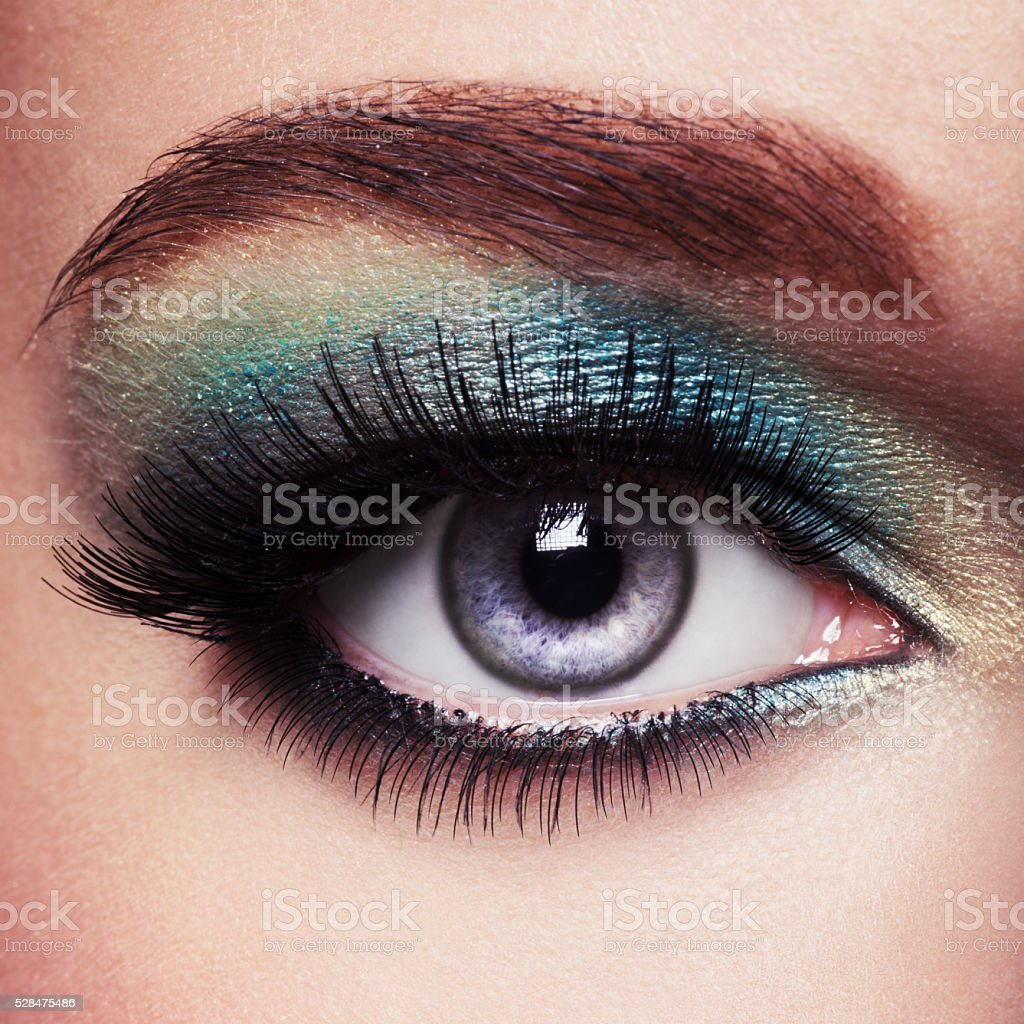 Woman eye with green make-up. Long eyelashes stock photo