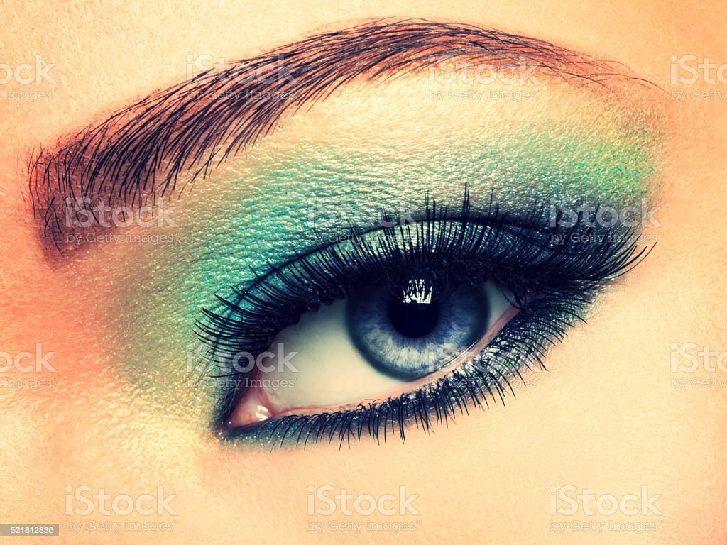 Woman eye with green make-up stock photo