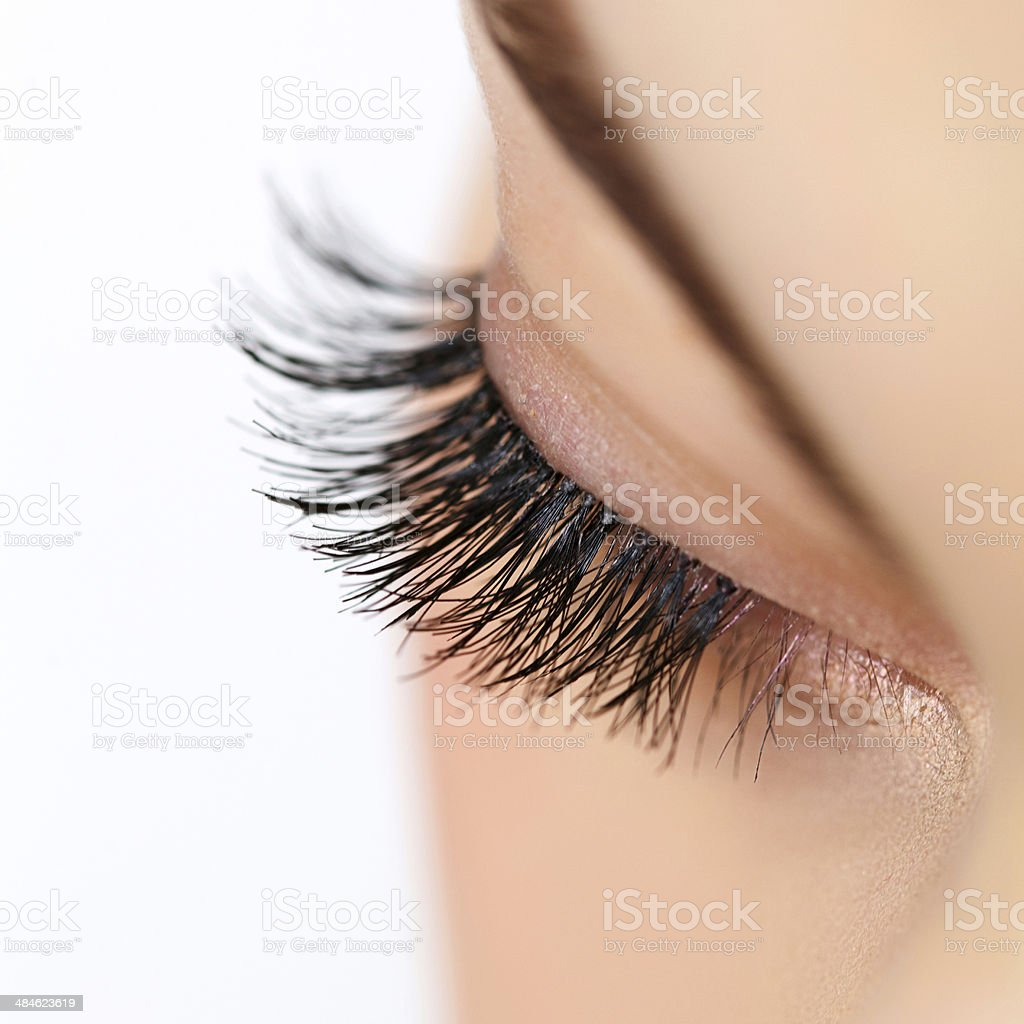 Woman eye with long eyelashes. Eyelash extension stock photo