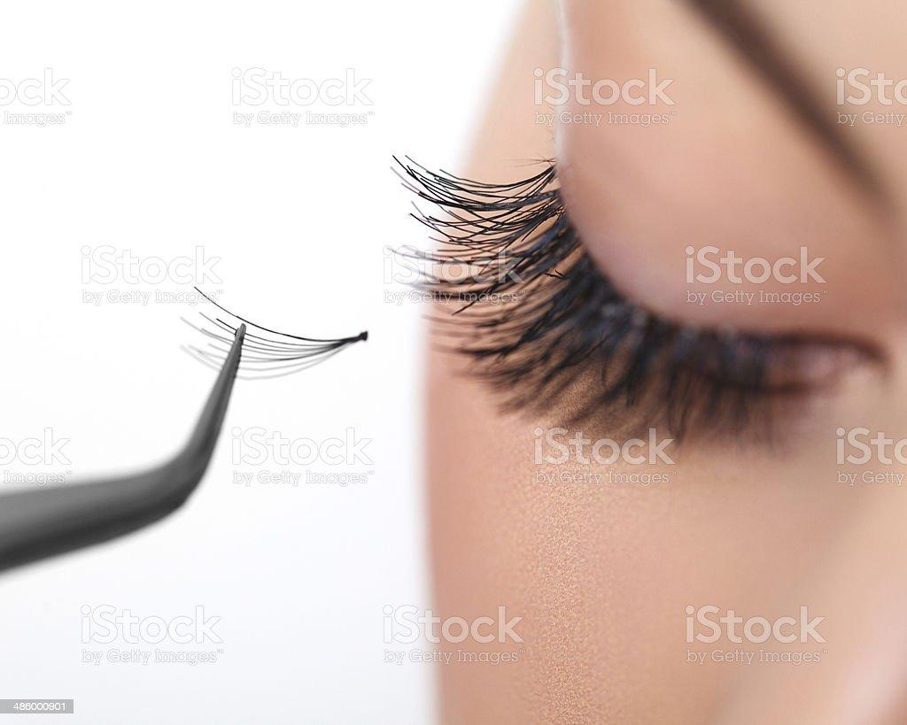 Woman eye with long eyelashes. Eyelash extension royalty-free stock photo
