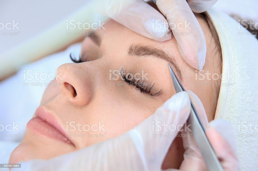 woman eyebrow correction royalty-free stock photo