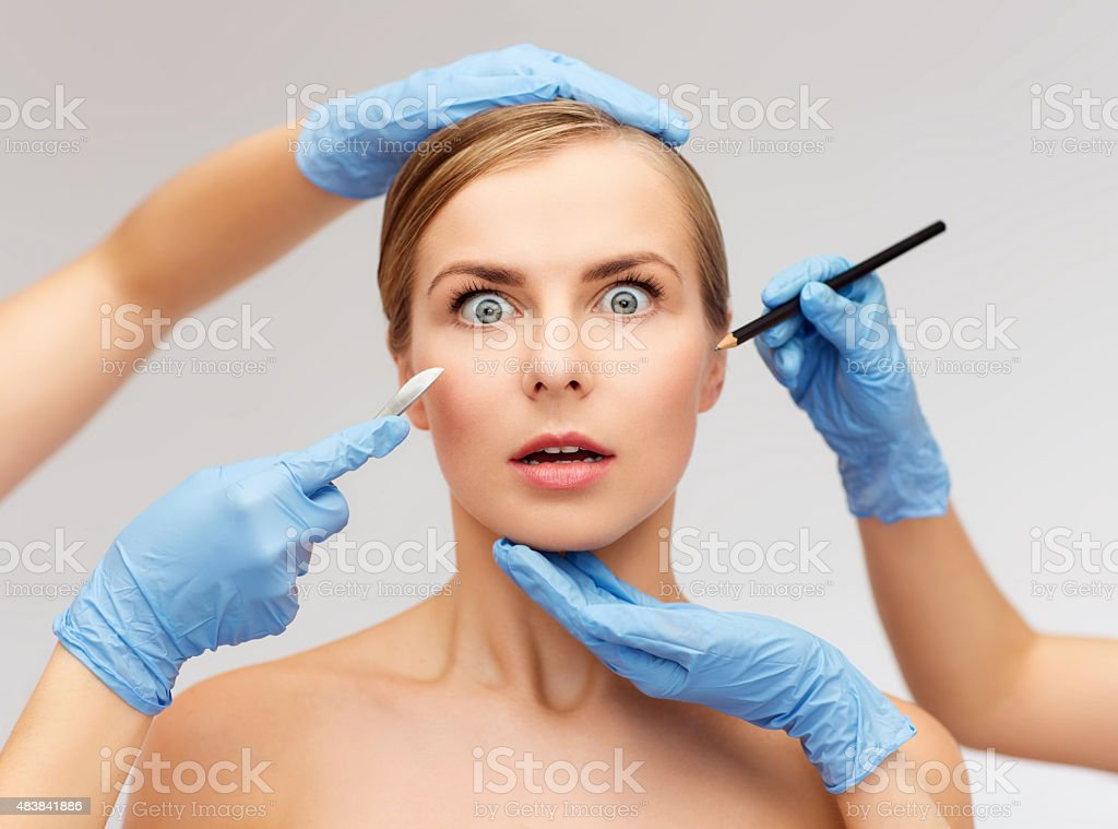 woman face and beautician hands with pencil stock photo