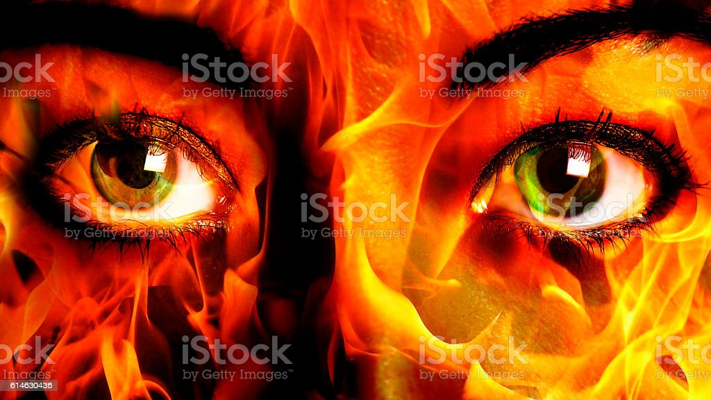 Woman Face fire Close up stock photo
