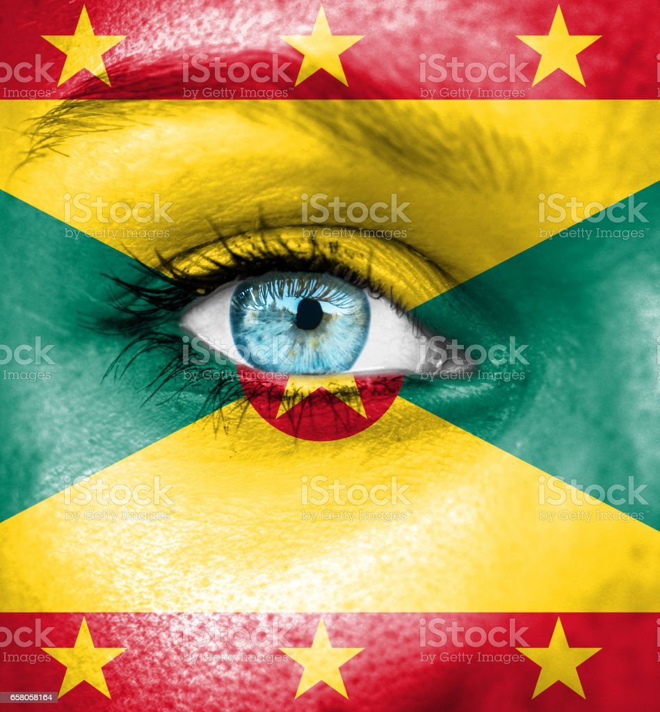Woman face painted with flag of Guernsey stock photo