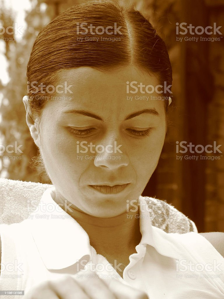 Woman face [sepia] #4 royalty-free stock photo