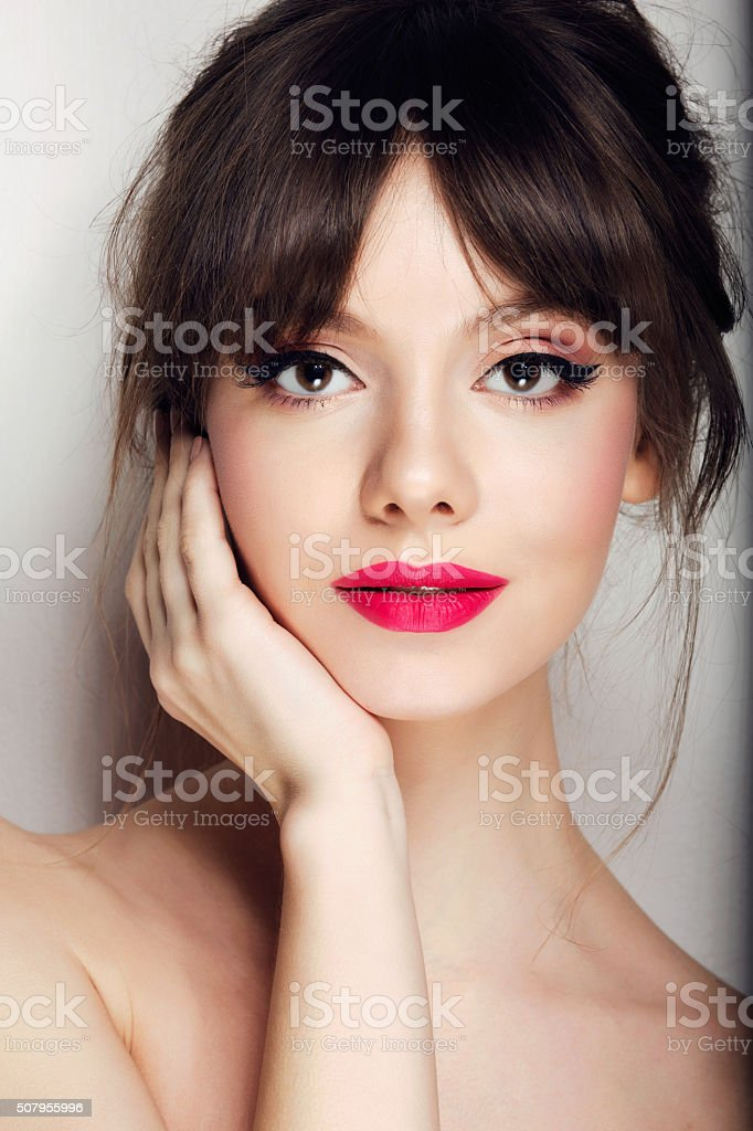Woman face with hair motion pink lipstick, smile stock photo