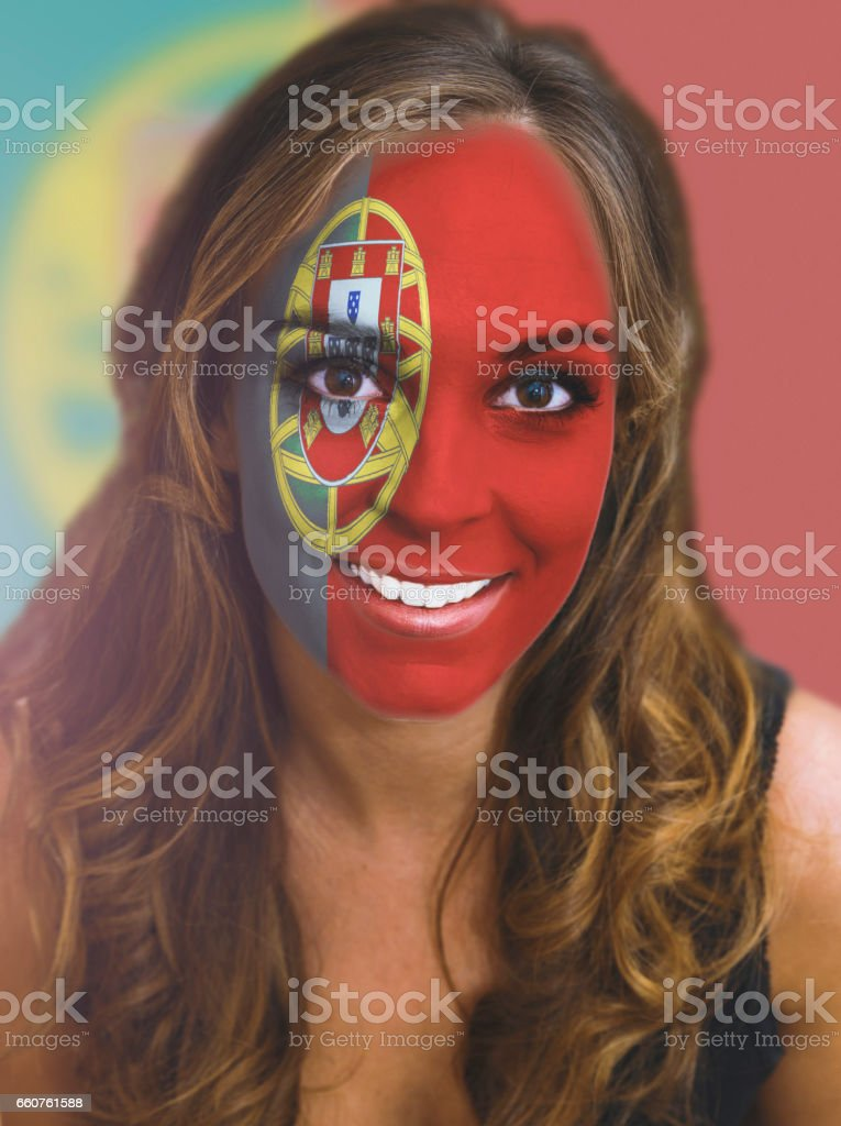 Woman face with painted flag of Portugal stock photo
