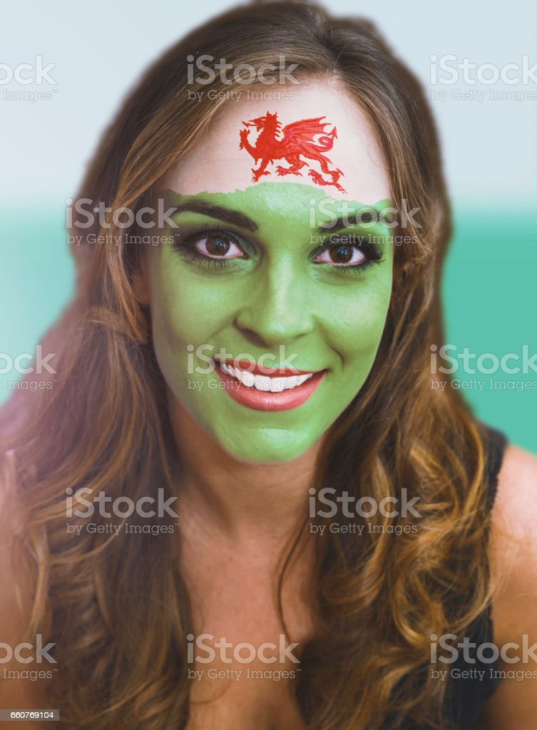 Woman face with painted flag of Wales stock photo