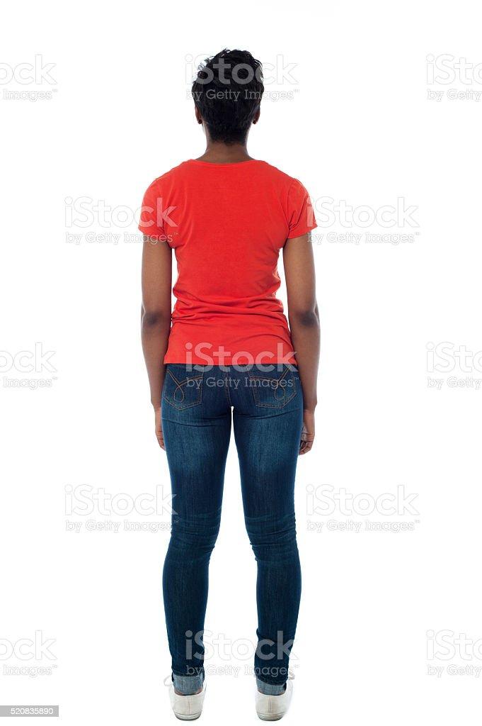 Woman facing towards the wall stock photo