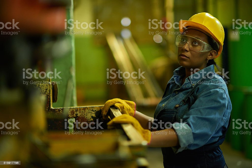 Woman factory worker stock photo