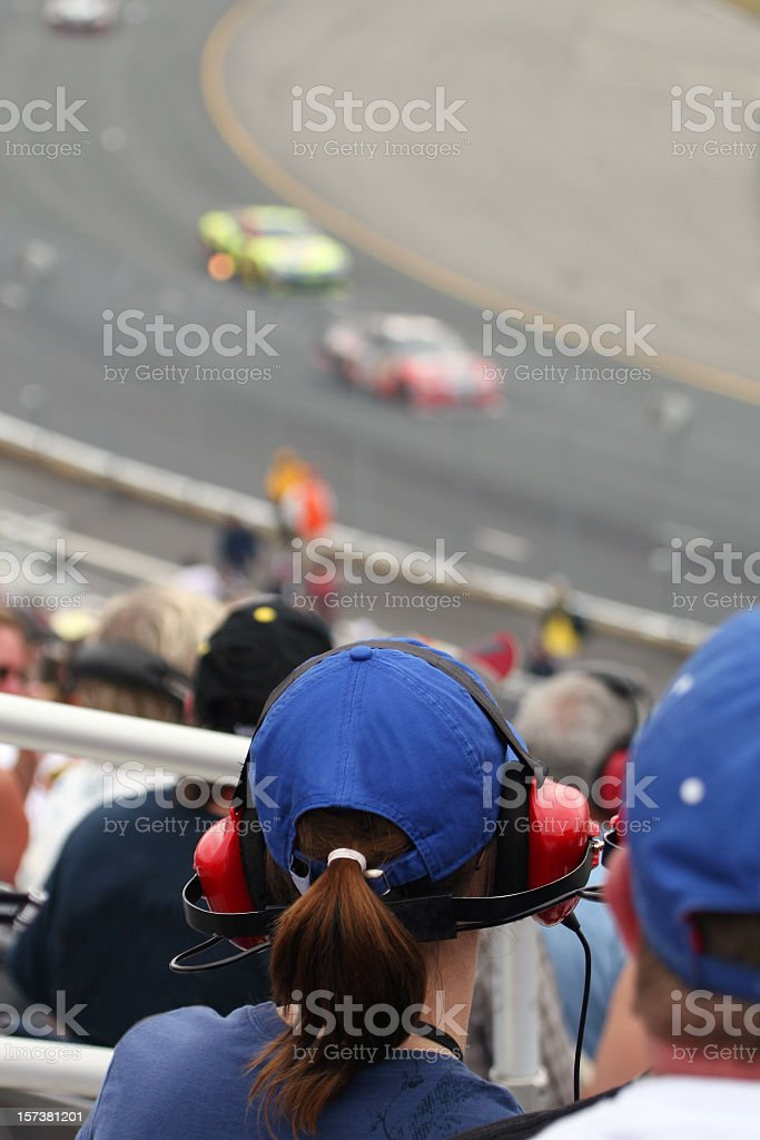 Woman Fan at Racing Event and Looking at Race stock photo