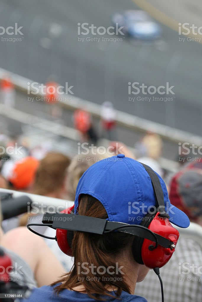 Woman Fan at Racing Event and Looking at Race royalty-free stock photo