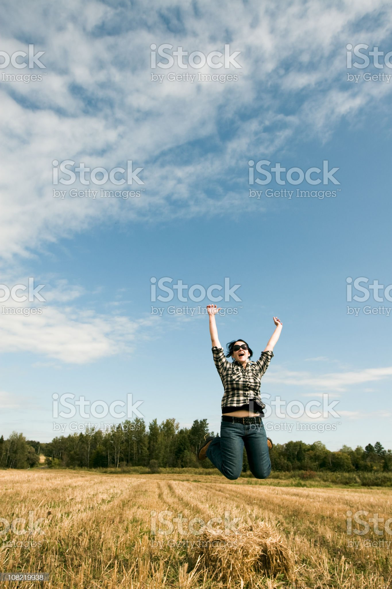 Woman Farmer Jumping for Joy in Field royalty-free stock photo