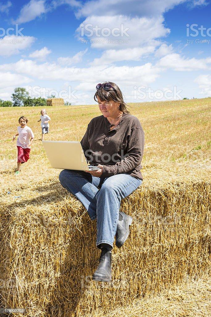 Woman farmer using a lap top on the farm royalty-free stock photo