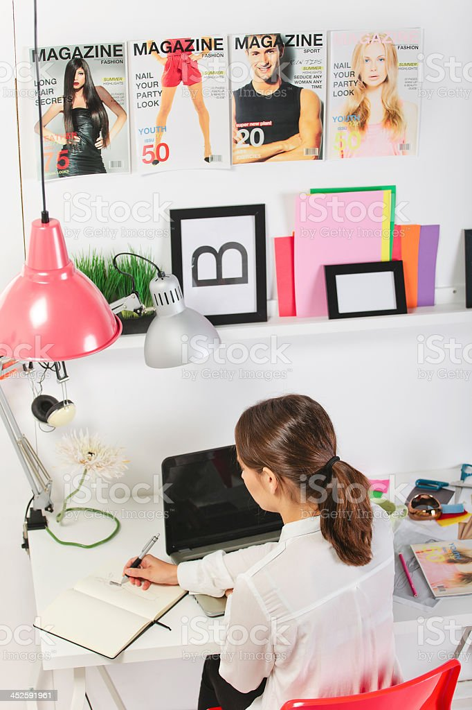 Woman fashion blogger working in a creative office stock photo