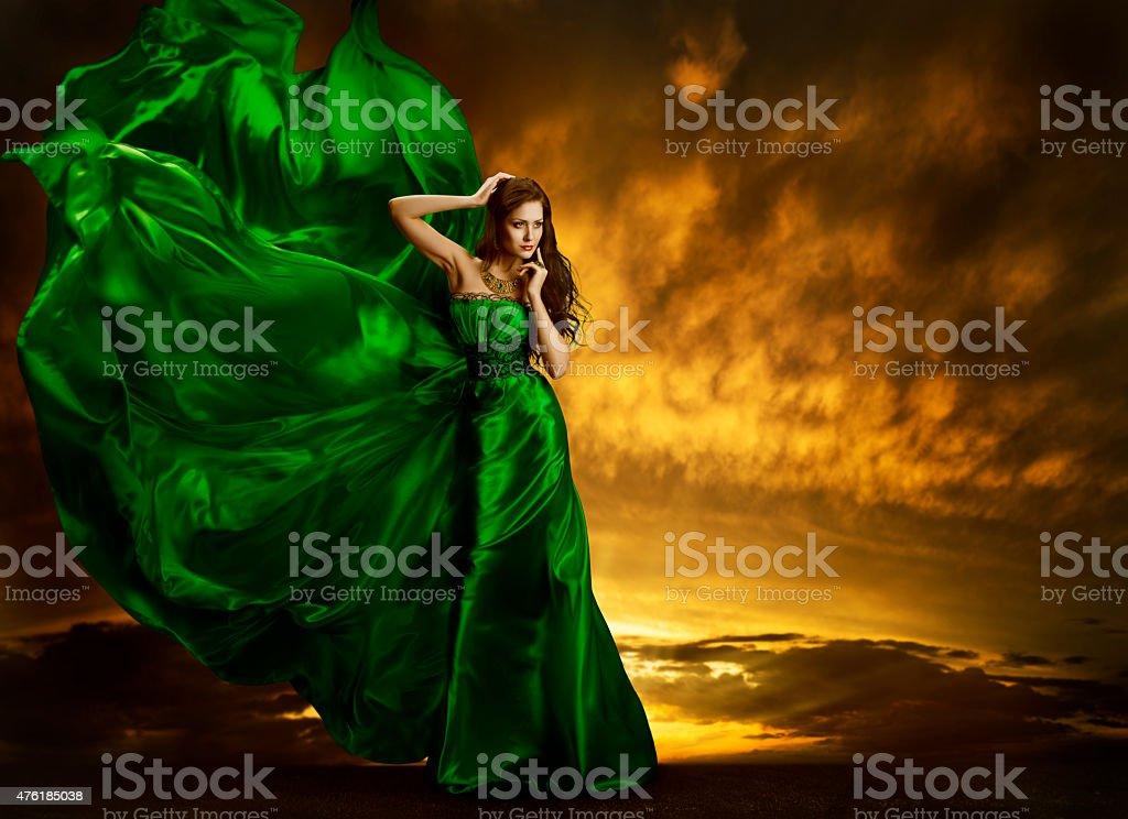 Woman Fashion Dress Fluttering, Model Posing Green Silk Gown Fabric stock photo