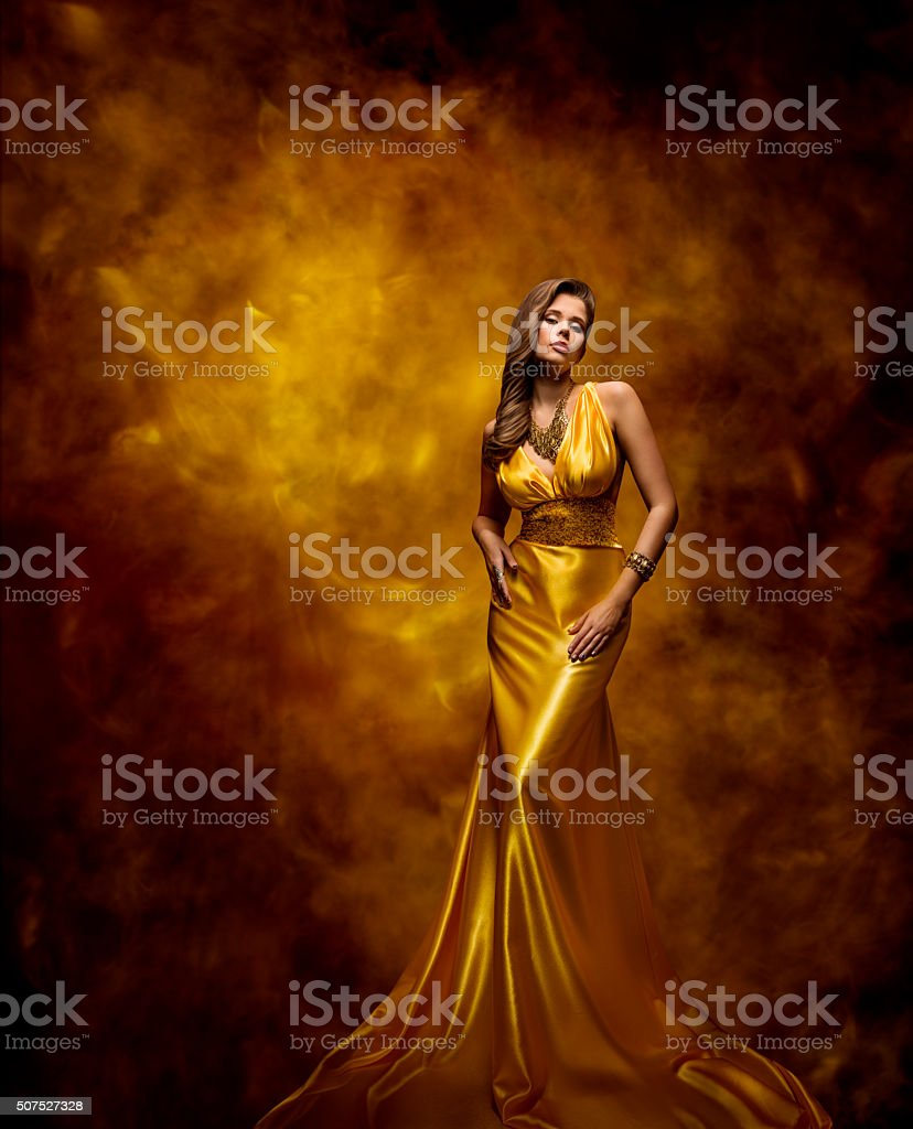 Woman Fashion Model Gold Dress, Beauty Girl in Glamour Gown stock photo