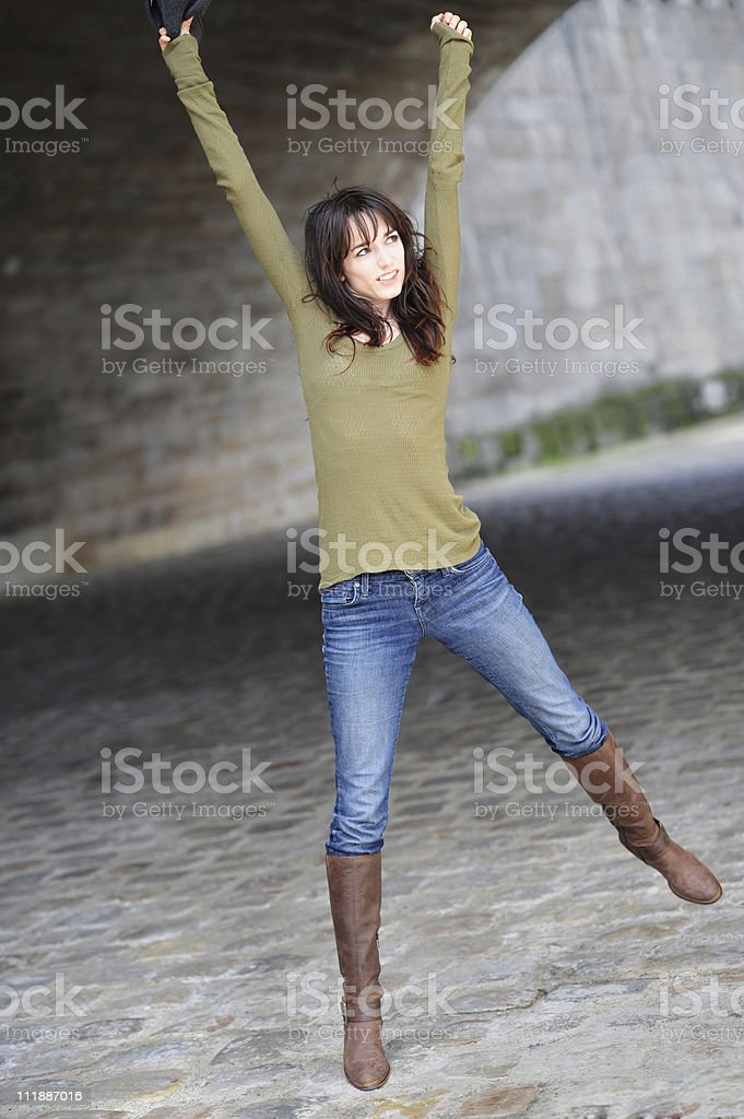 Woman Fashion Model Jumping under Bridge along Seine River France stock photo