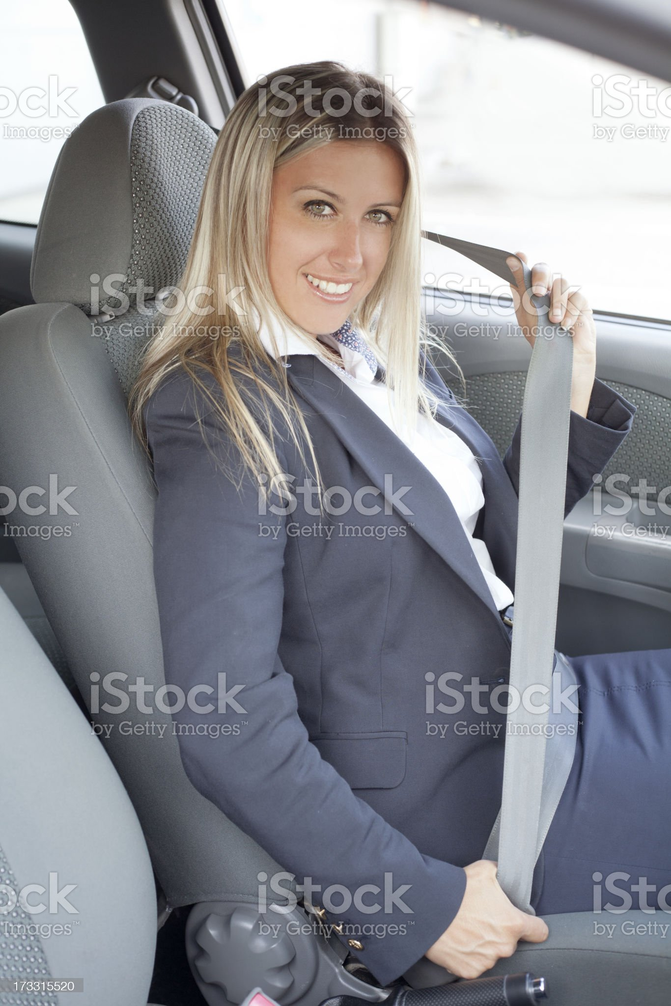 woman fastening safety belt in car royalty-free stock photo