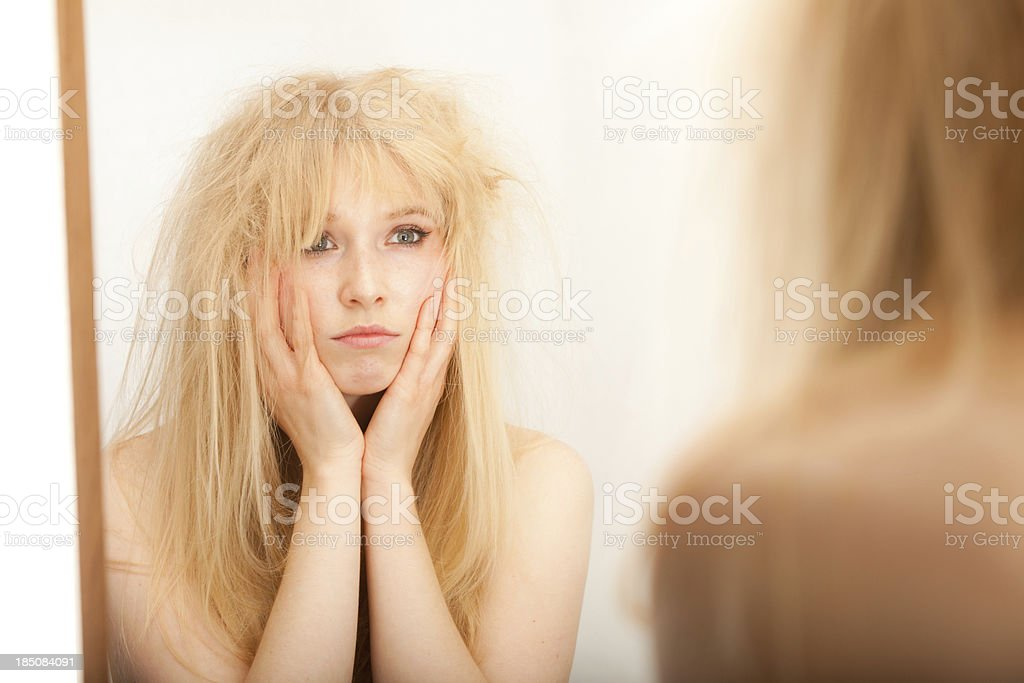 Woman Fed Up with her Hair stock photo