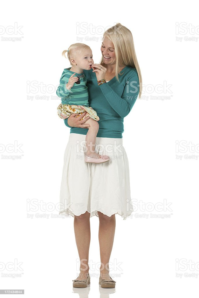 Woman feeding her daughter royalty-free stock photo