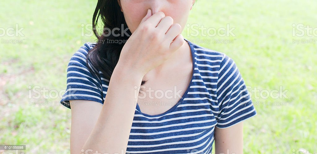 Woman feeling bad smell stock photo