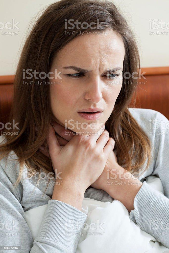 Woman feeling sore throat stock photo