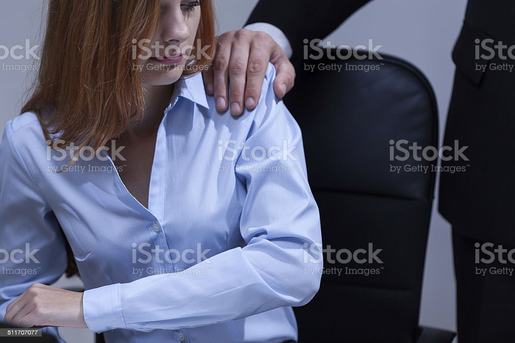 Woman feeling uncomfortable at work stock photo