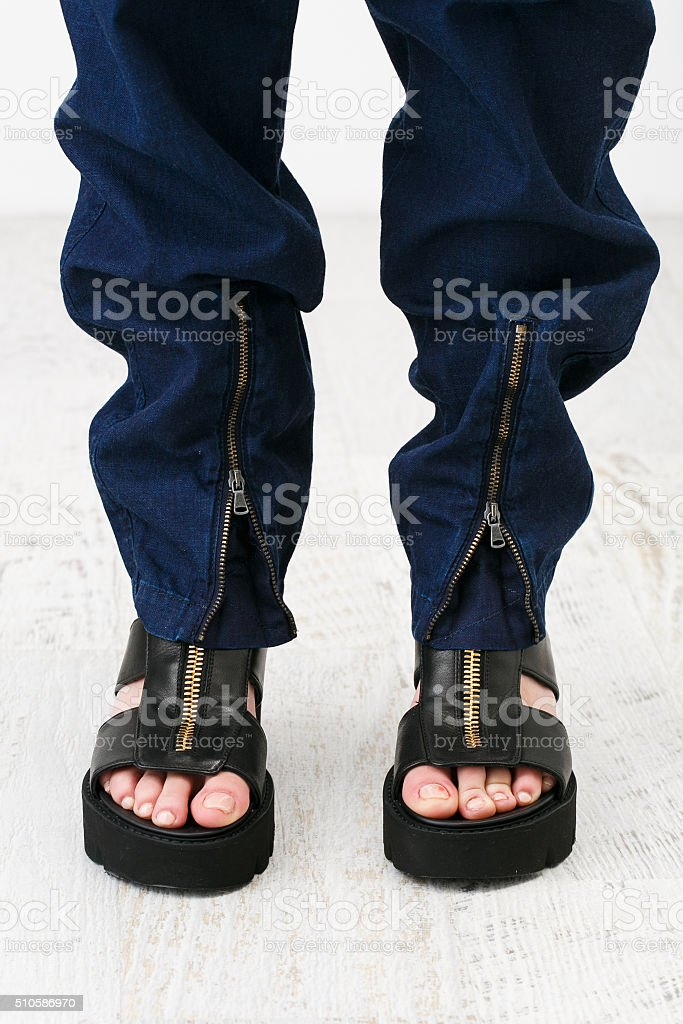 Woman feet in the chunky sandals stock photo