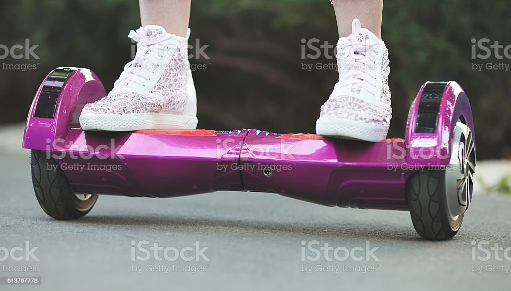 woman feet on hoveboard stock photo