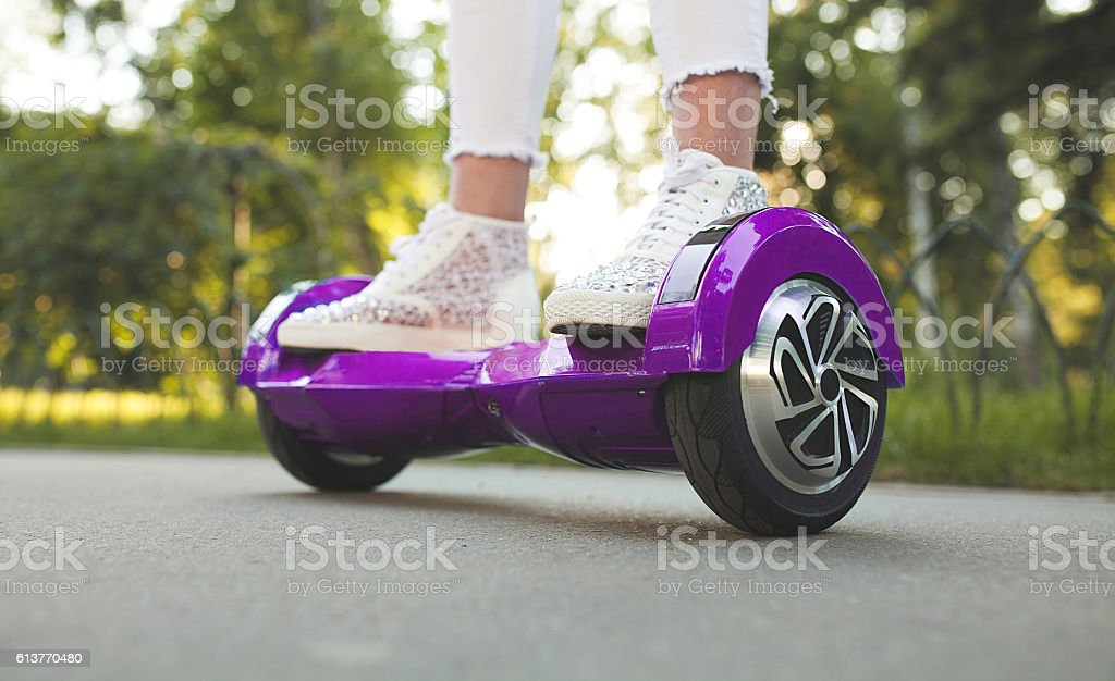 woman feet on hoverboard stock photo