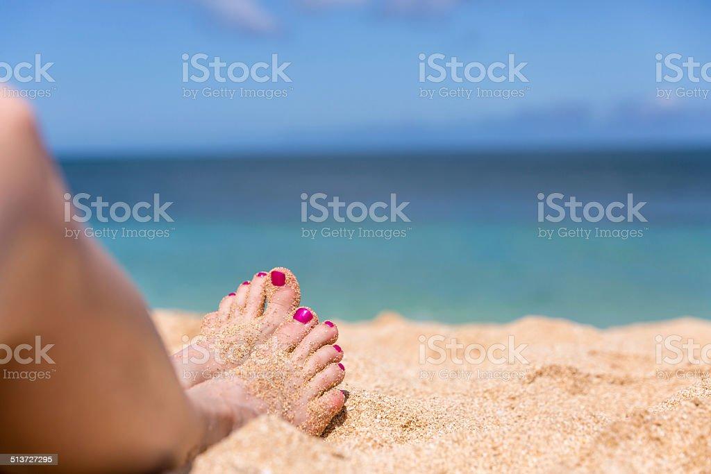 Woman Feet on Tropical Sand Beach stock photo