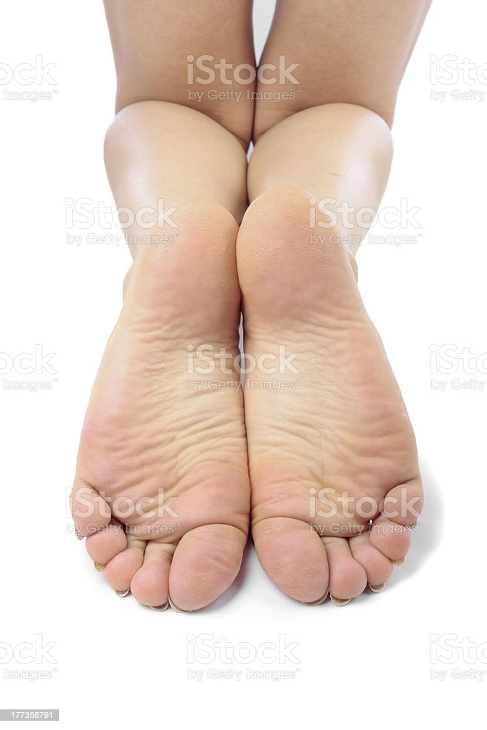 Woman feet over white stock photo