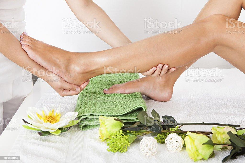 Woman Feet Undergoing Massage stock photo