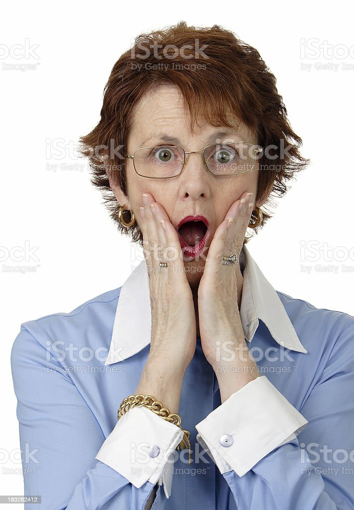 A woman feigning shock with her hands to her face royalty-free stock photo
